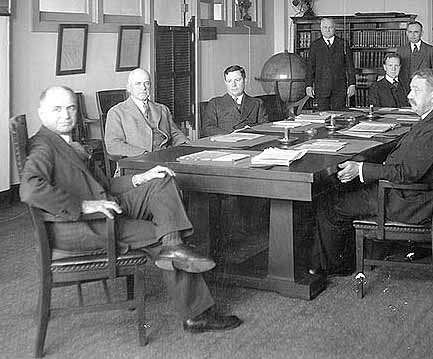 Rear Admiral Mark L. Bristol (far left), in a meeting at the Navy Department, Washington, D.C., 1932
