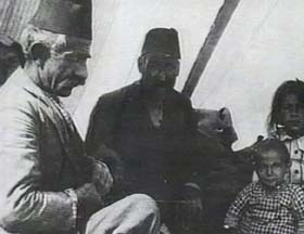 An Armenian family sitting in a tent inside a refugee