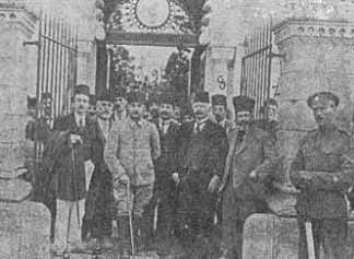Gallows humor from the British; the Malta detainees pose in front of the Malta cemetery
