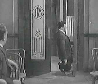A beaten Gene Kelly is dropped by the door